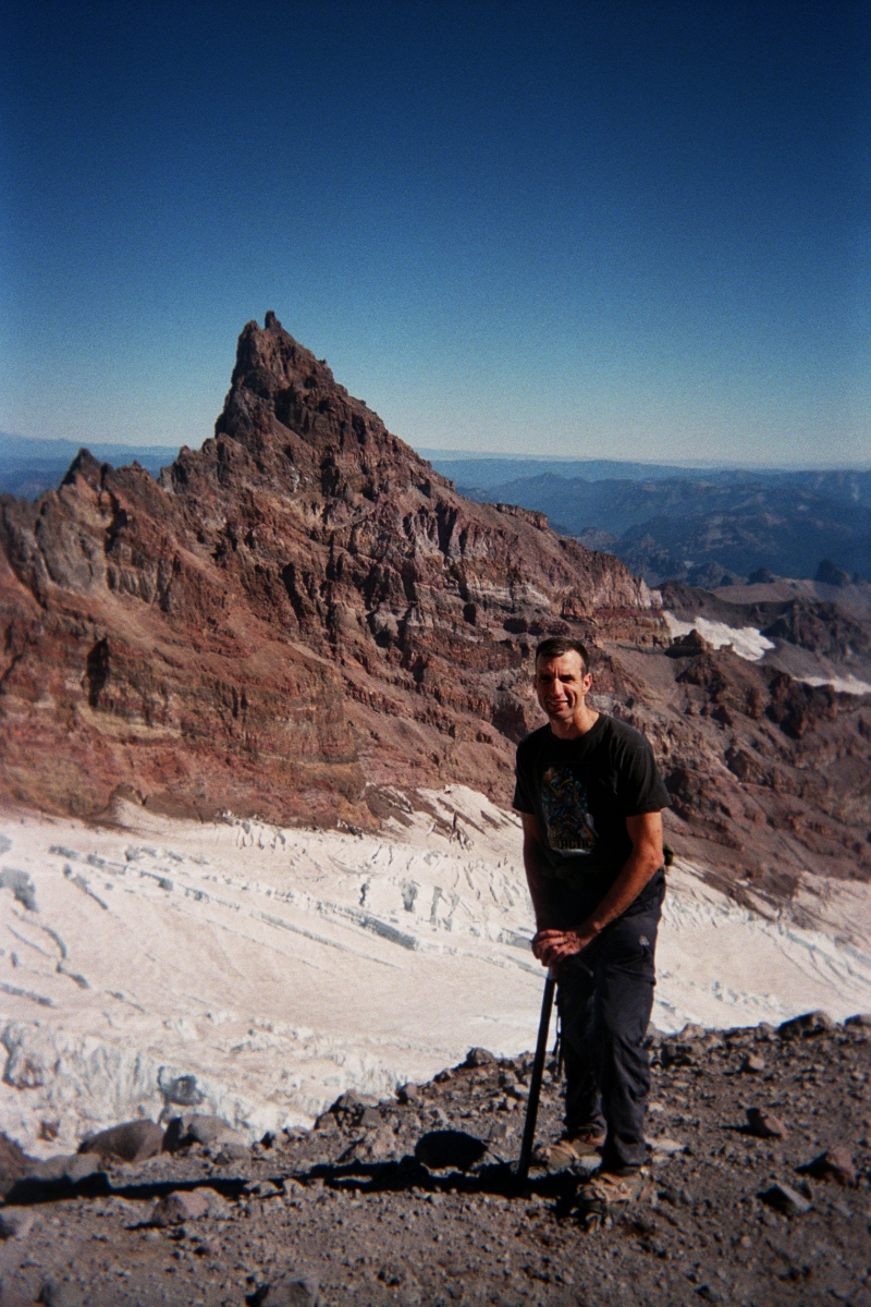 Enjoying Health & Fitness at10,000 feet on Mt. Rainier. Mt. St. Helen in background